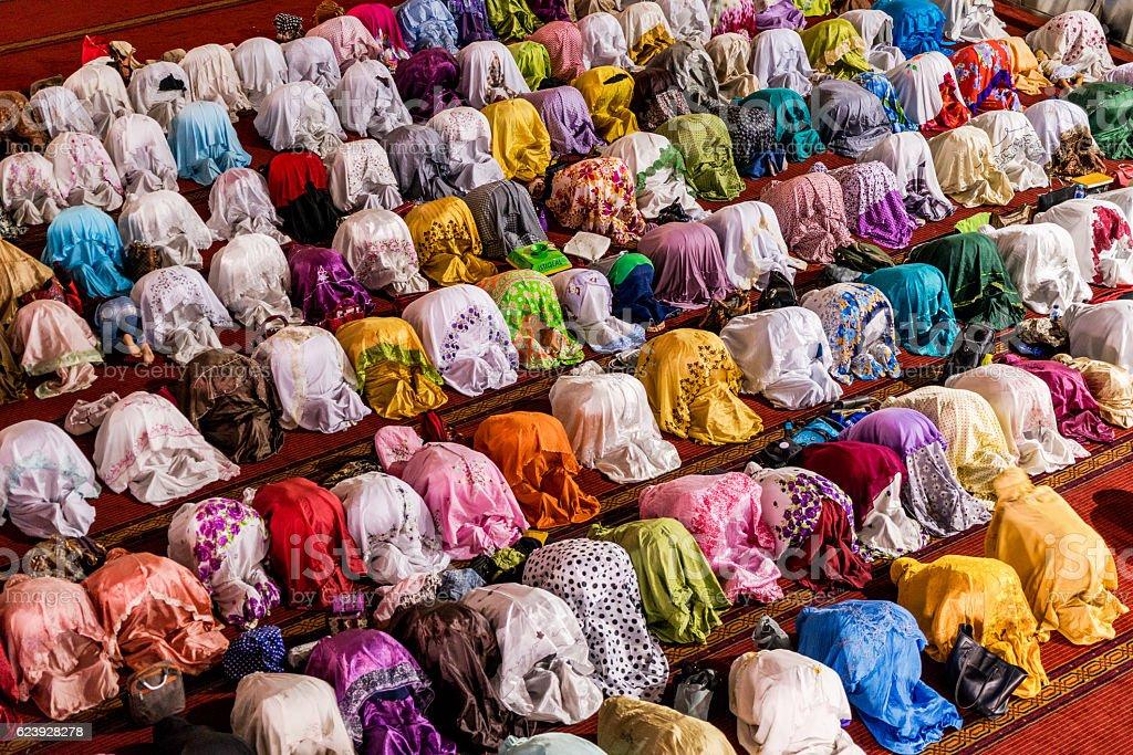 Muslim women praying in mosque stock photo