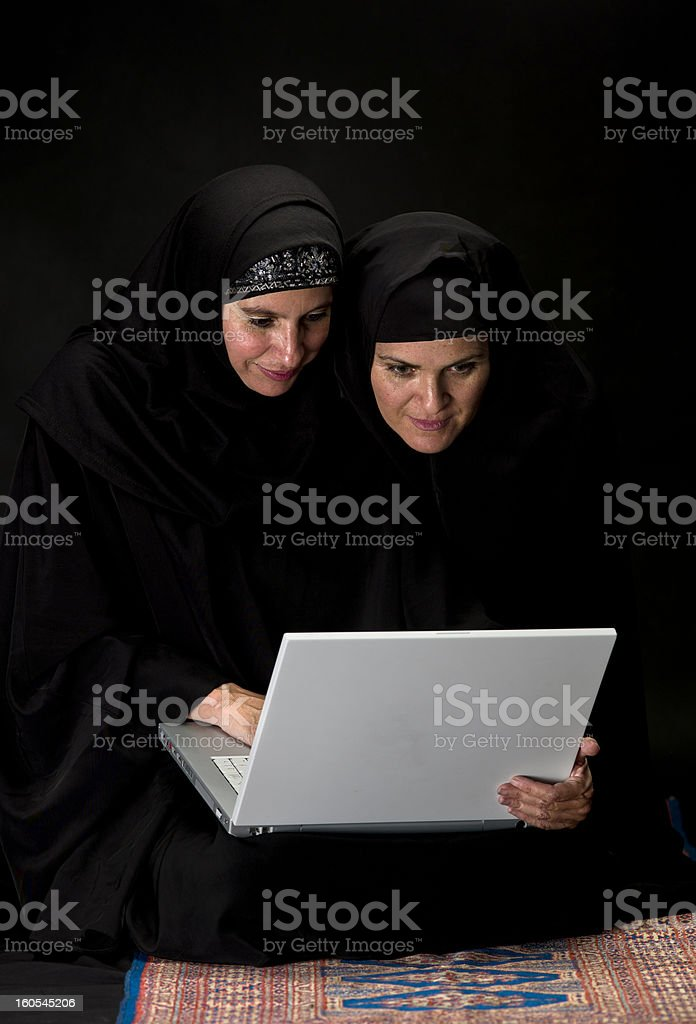 Muslim women using Internet royalty-free stock photo