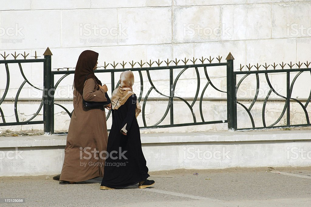 Muslim women walking to the mosque royalty-free stock photo