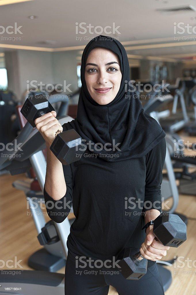 Muslim Young Woman Exercising stock photo