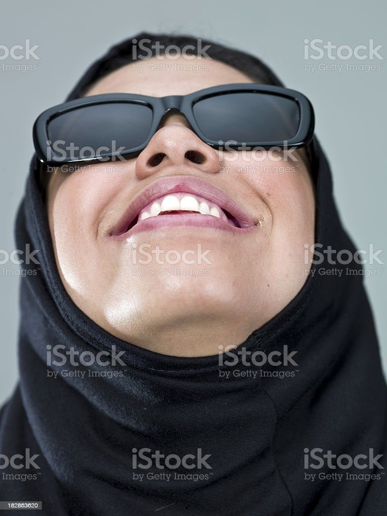 muslim young woman looking up royalty-free stock photo