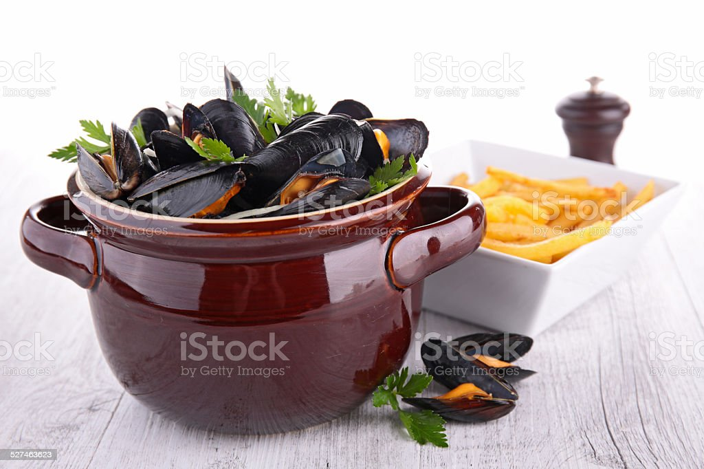 mussel and french fries stock photo