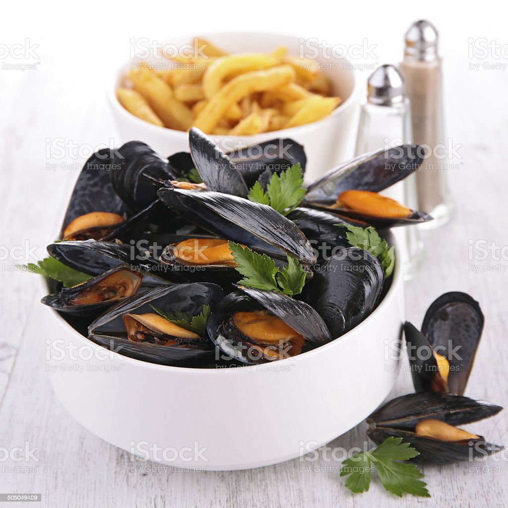 mussel with parsley and french fries stock photo