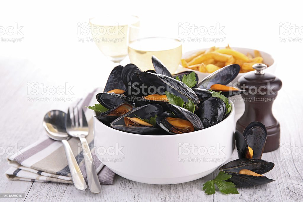 mussel with wine sauce and fries stock photo