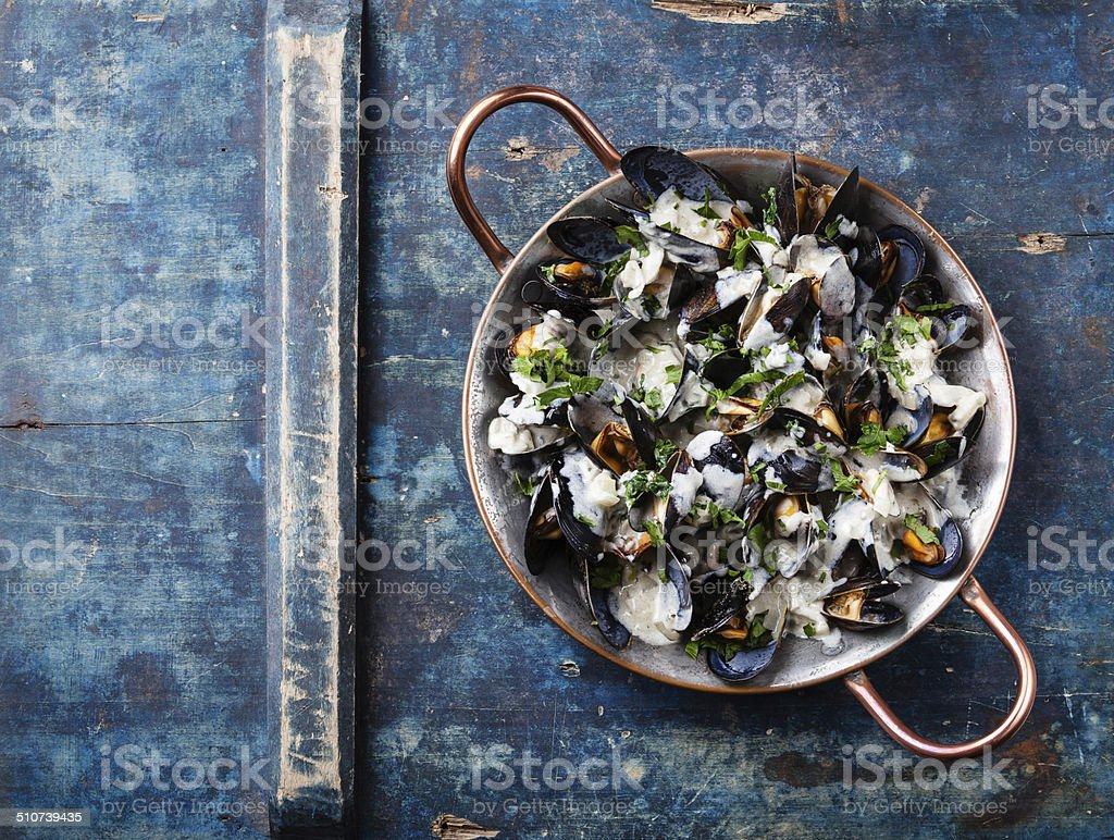 Mussels and Dor Blue sauce stock photo