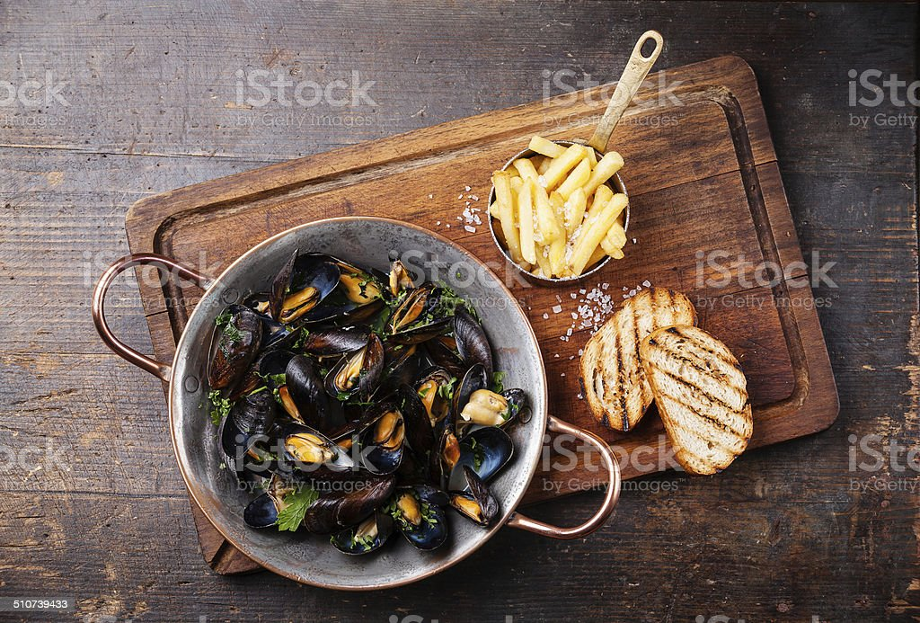 Mussels and french fries stock photo