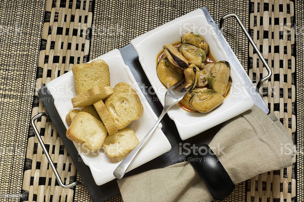 Mussels appetizer and toast royalty-free stock photo