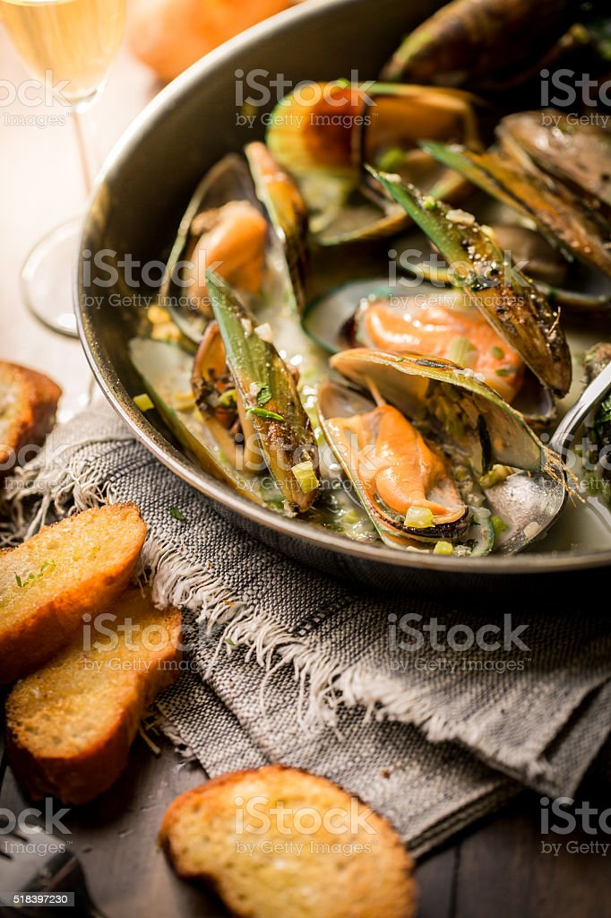 Mussels cooked with white bread stock photo
