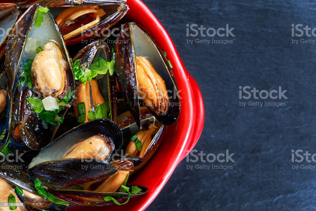 Mussels  garlic butter sauce in Red bowl. stock photo