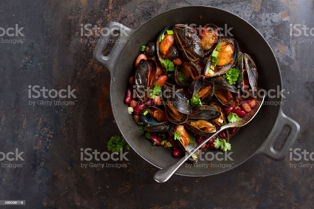 Mussels in cast iron pot stock photo