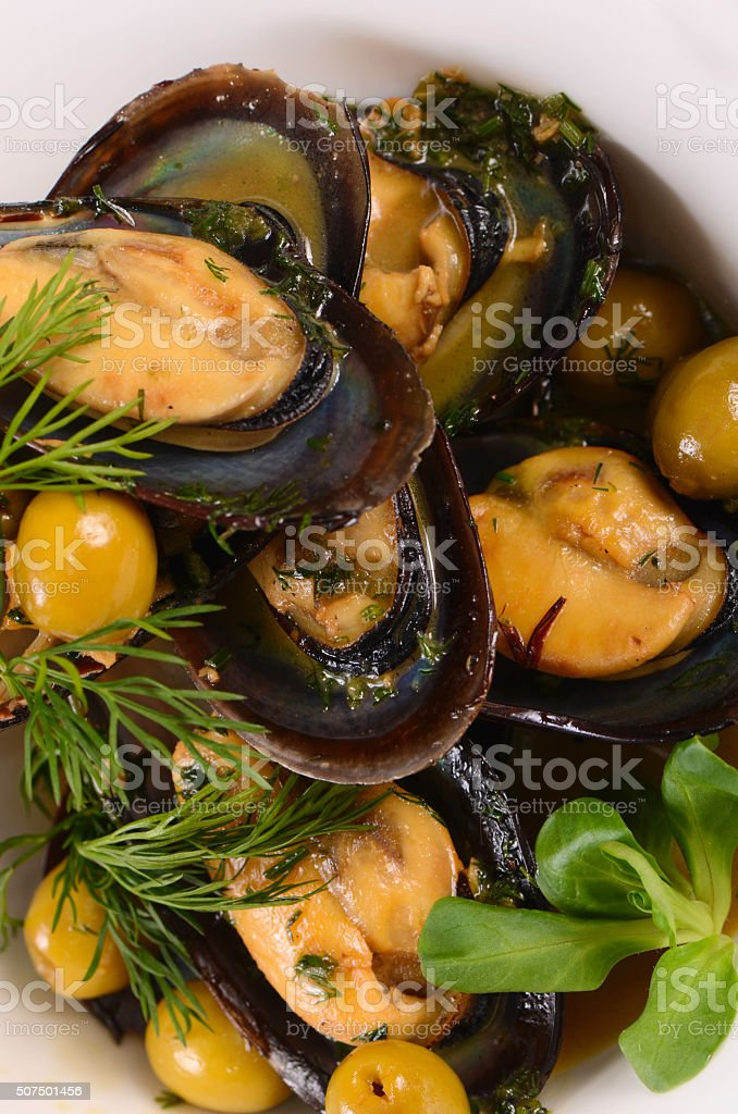 Mussels in the shell with sauce stock photo