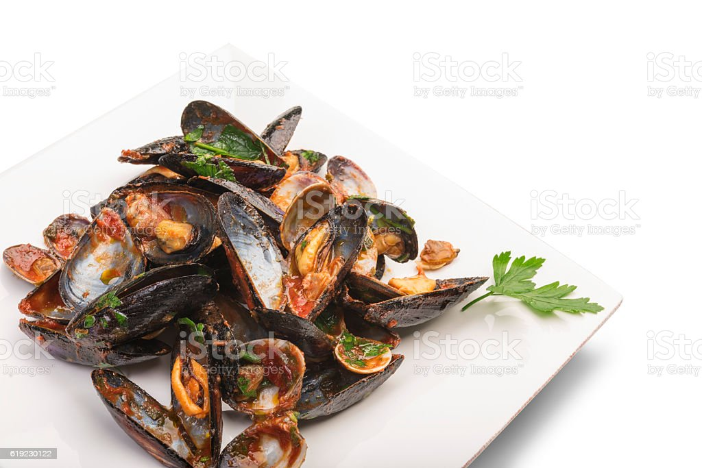 Mussels seafood with tomato sauce on white plate stock photo