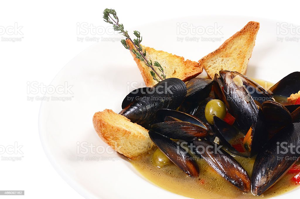Mussels Tuscan with crispy ciabatta stock photo