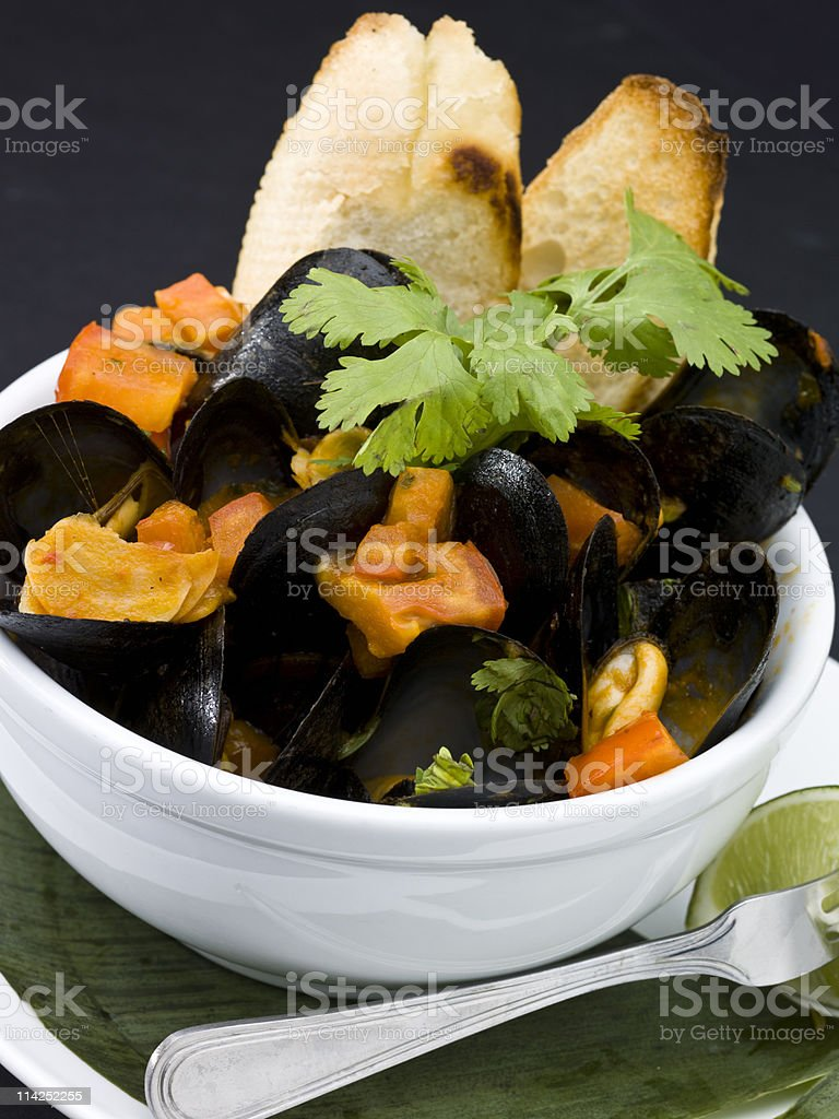 Mussels with diced tomatoes stock photo