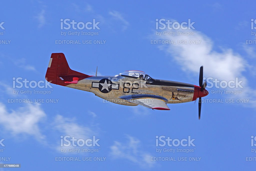 P-51 Mustang 'Red Tail' airplane flying at air show stock photo