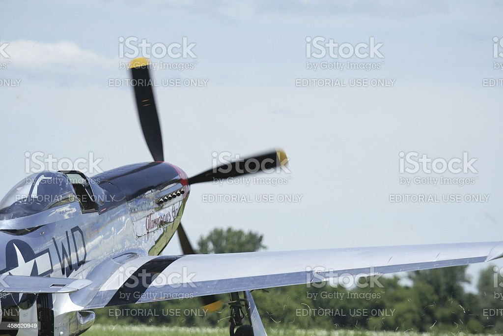 P-51D Mustang WWII Military Fighter Airplane Kicking Up Swirling Grass stock photo