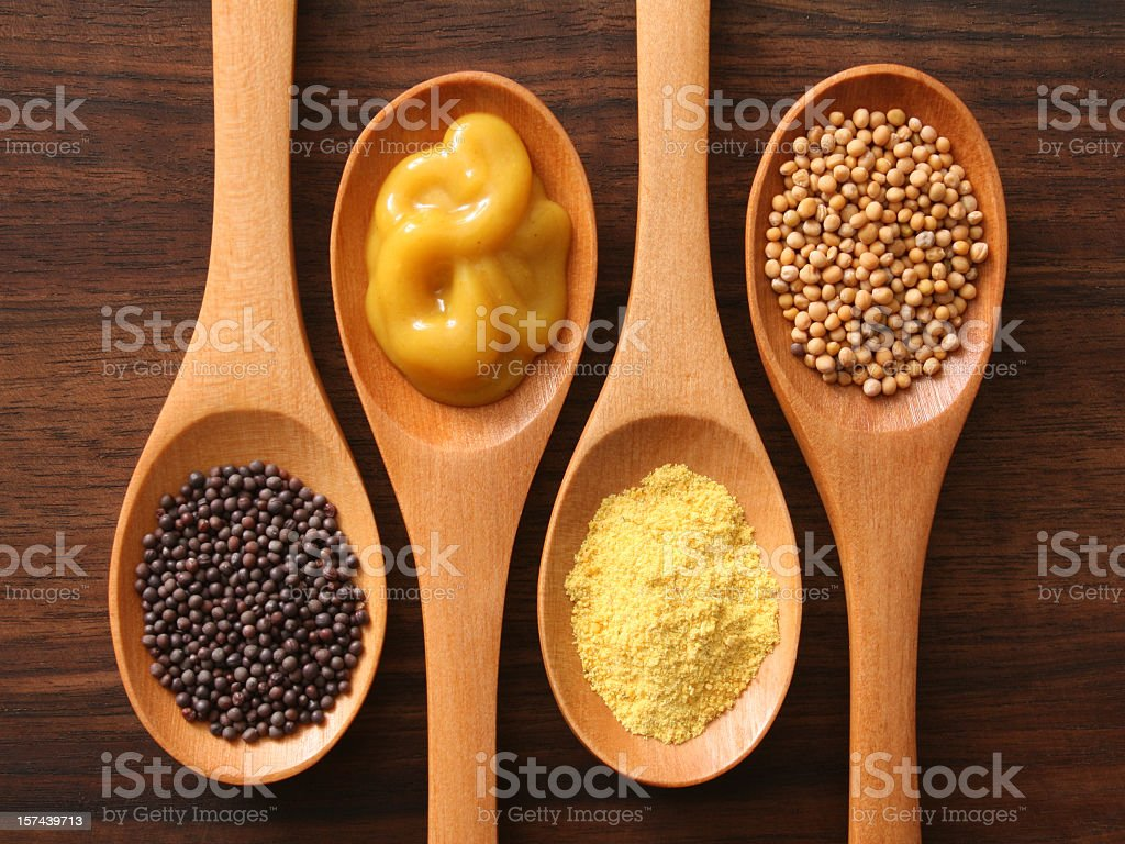 Mustard and spoons stock photo