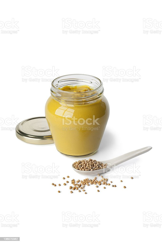 Mustard in a jar and seeds stock photo