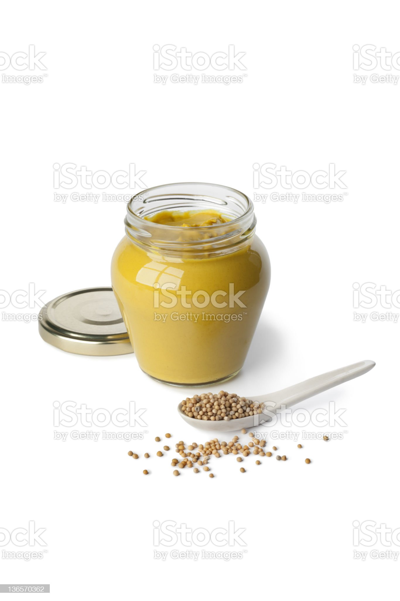 Mustard in a jar and seeds royalty-free stock photo