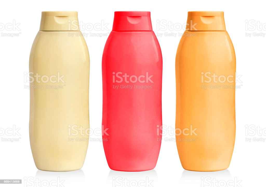 mustard, ketchup and mayonnaise in plastic bottles stock photo