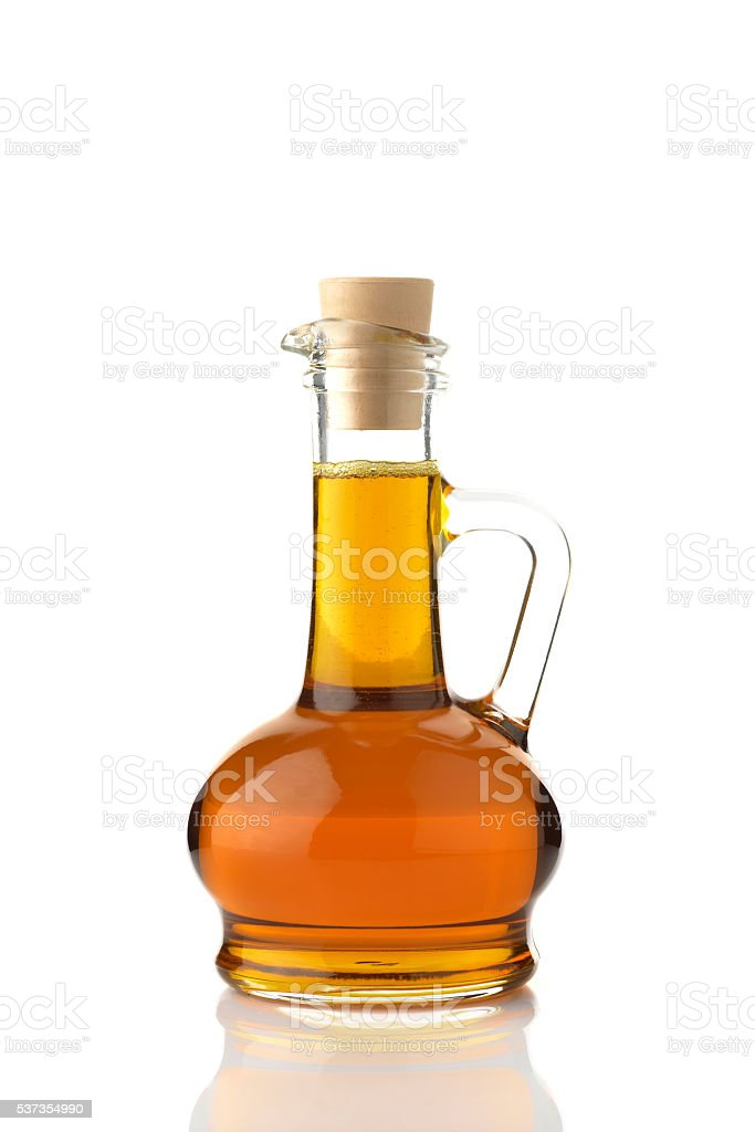 Mustard Oil on White Background stock photo