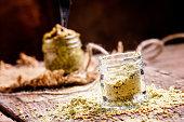 Mustard powder in a glass jar