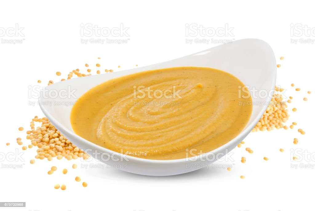 Mustard sauce and seeds isolated on white stock photo