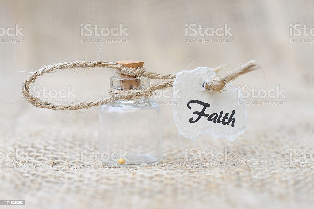 Mustard seed in a jar signifying faith royalty-free stock photo
