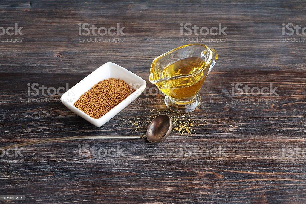 Mustard seeds and mustard oil stock photo