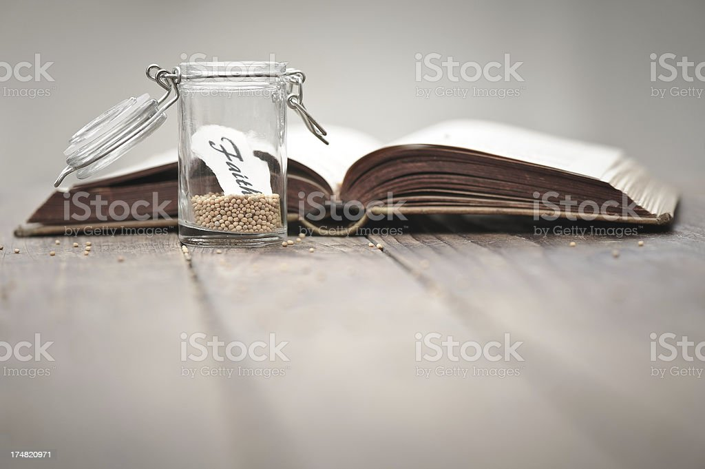 Mustard seeds in a jar and bible royalty-free stock photo
