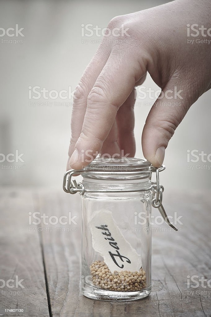 Mustard seeds in a jar signifying faith royalty-free stock photo