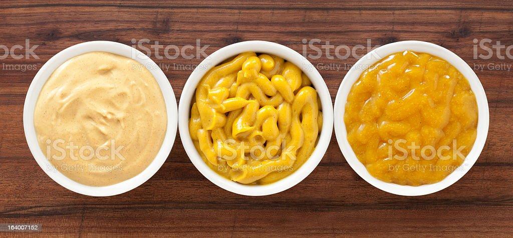 Mustard spreads stock photo