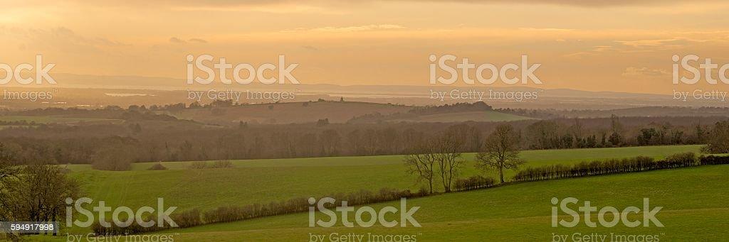 Muted sunset at Bignor Hill stock photo