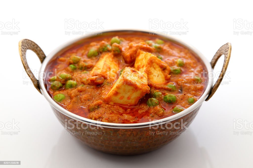 Mutter Paneer , Indian Dish Cottage cheese and Peas immersed in stock photo