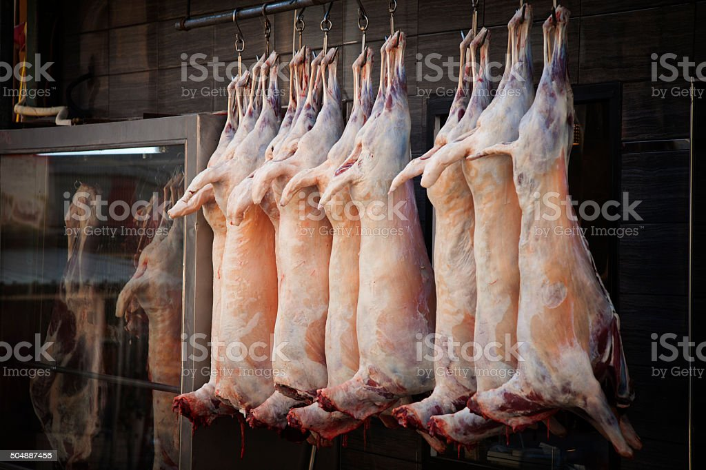 Mutton hanged in a butchery stock photo
