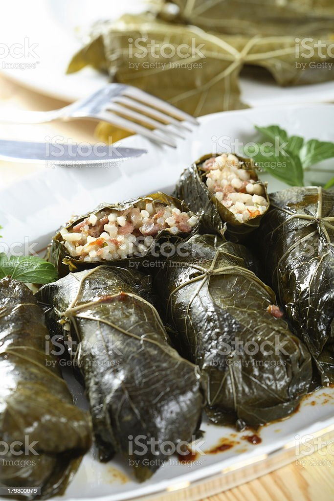 Mutton with rice rolled into leafs royalty-free stock photo
