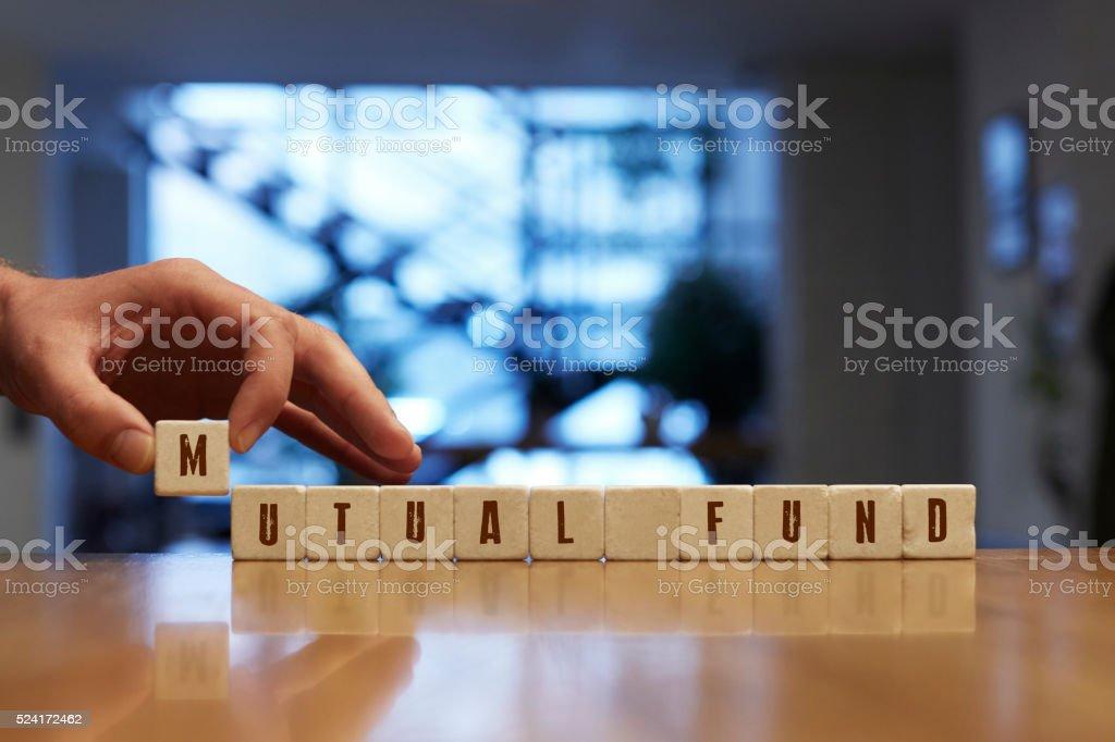 Mutual Fund Concept with Alphabet Blocks stock photo