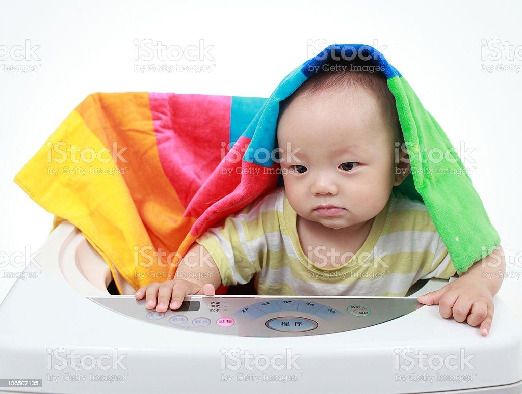 My baby and washing machine royalty-free stock photo