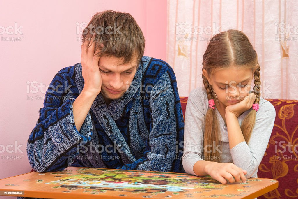 My daughter collects a picture from puzzles stock photo