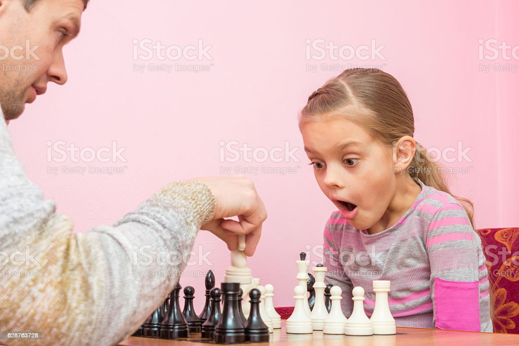 My daughter was surprised and opened her mouth when dad stock photo