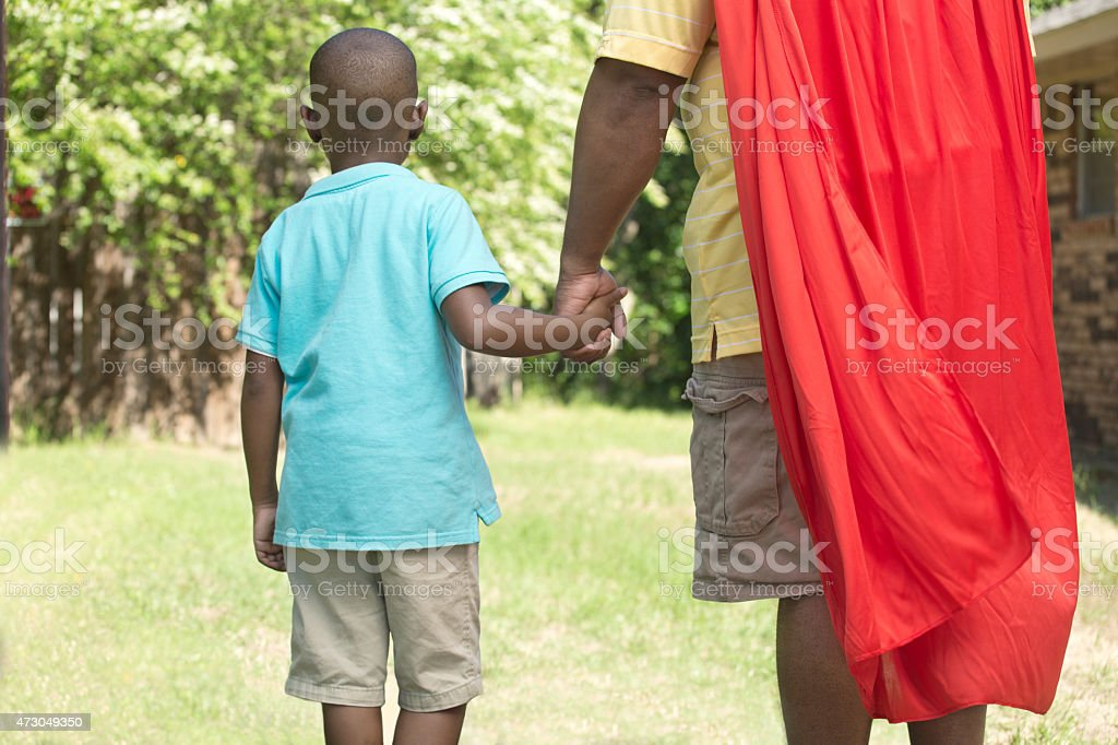 My father is my superhero. stock photo