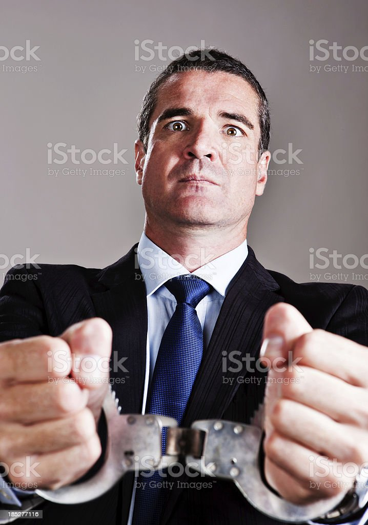 My hands are tied! Handsome businessman in handcuffs stock photo