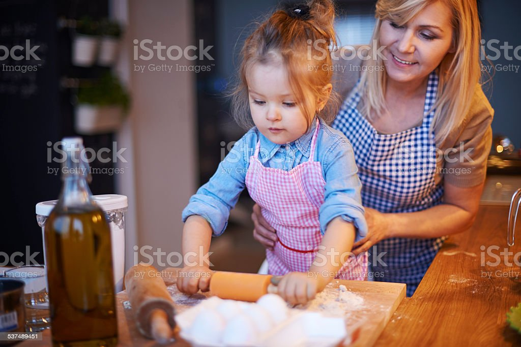 My little baker in the kitchen stock photo