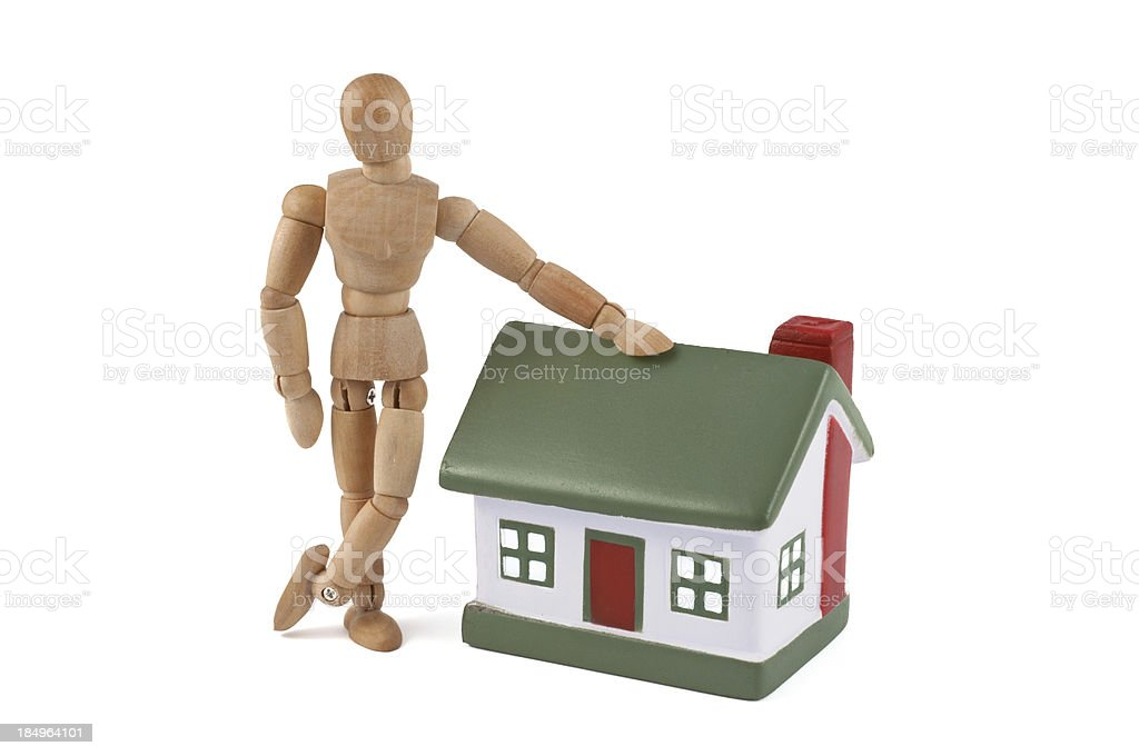 my new house - wooden mannequin with their home stock photo