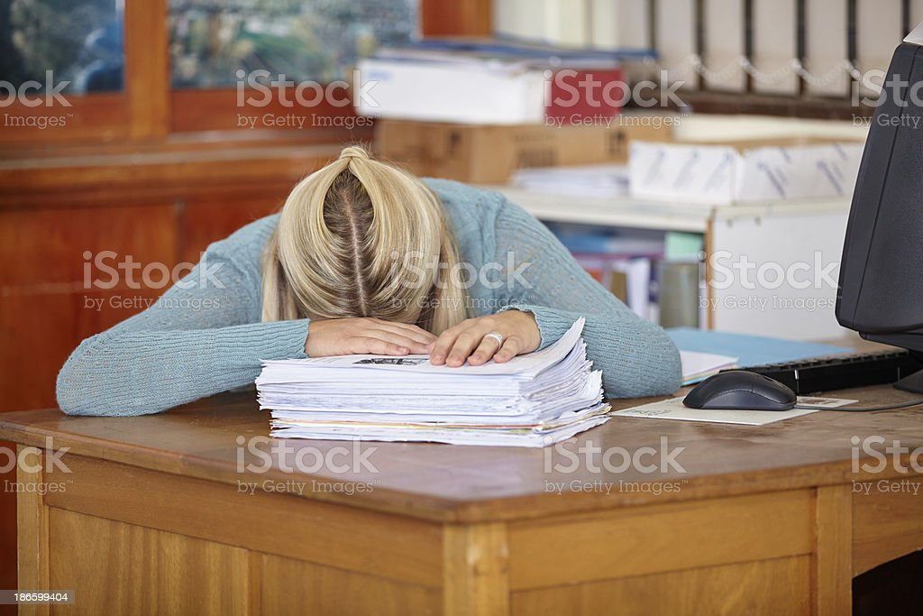 My pillow is this pile of marking papers stock photo