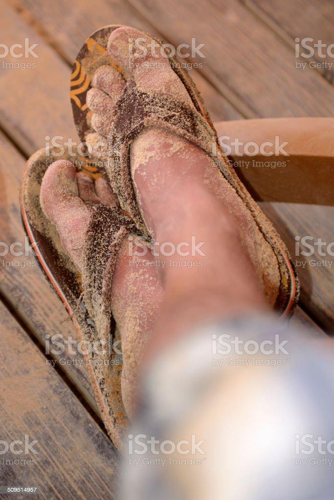 My sandy feet in flip flops stock photo