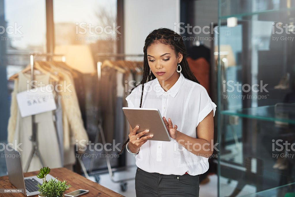 My tablet makes it easier to connect with my clientele stock photo