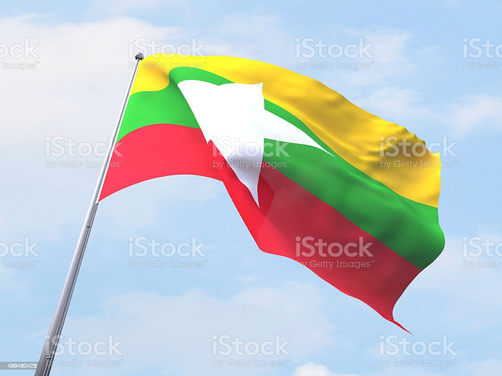 Myanmar flag flying on clear sky. stock photo