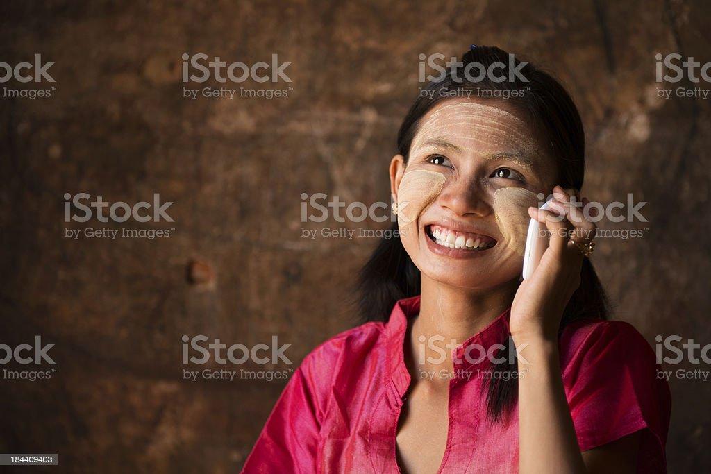 Myanmar girl using smart phone. royalty-free stock photo