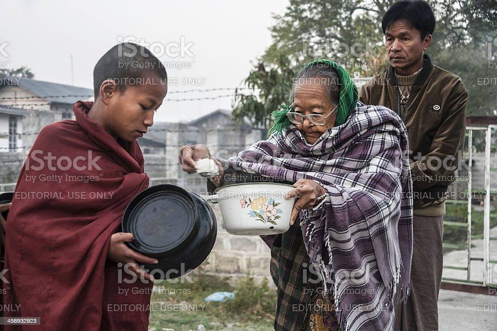 Myanmar: Monk Receiving Offering of Rice royalty-free stock photo